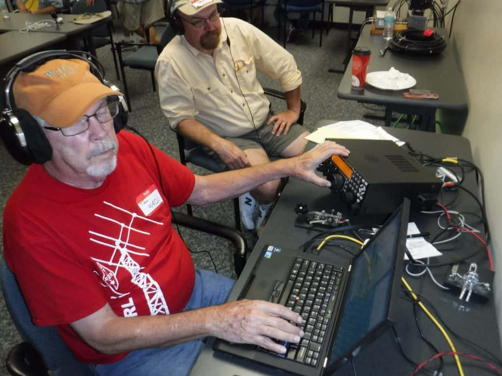 Tom W4CU operates the CW station with Mark KA4JVY
